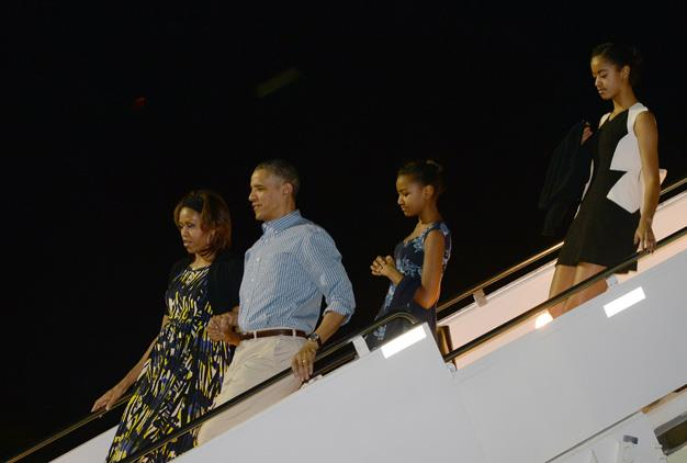 The First Family touchdown at Air Force One at Joint Base Pearl Harbor-Hickam in Honolulu for their holiday vacation in December 2013.