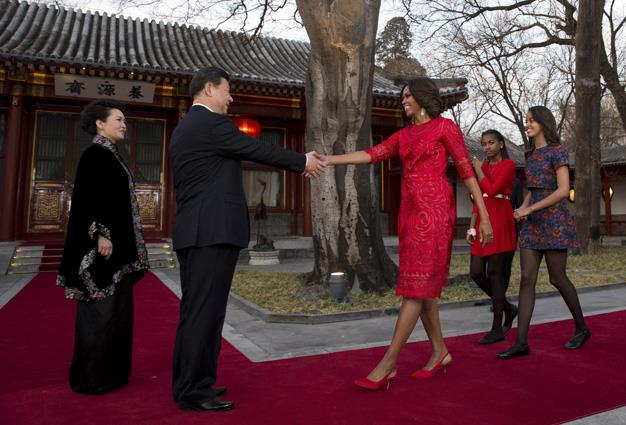Michelle Obama took daughters Malia and Sasha on her state visit of China where they were greeted by Chinese President Xi Jinping and his wife Peng Liyuan in Beijing.