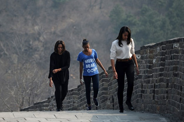 Walking with her daughters on the Great Wall of China.