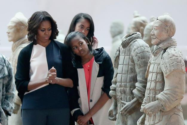 First Lady Michelle Obama with her daughters Malia Obama and Sasha Obama visit Museum of Terracotta Warriors.