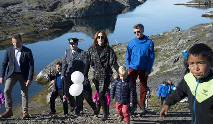 The Danish royals make their way up the slope.