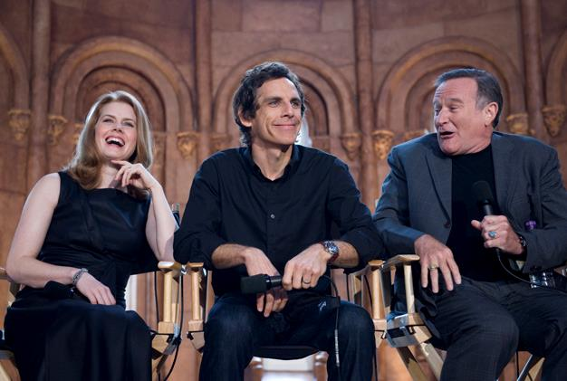 Williams with his *Night at the Museum: Battle of the Smithsonian* co-stars, Amy Adams and Ben Stiller.