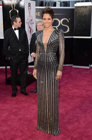 Halle looked flawless in this custom-made Atelier Versace gown featuring a plunging neckline and ombre stripe detail at the Oscars in 2013.
