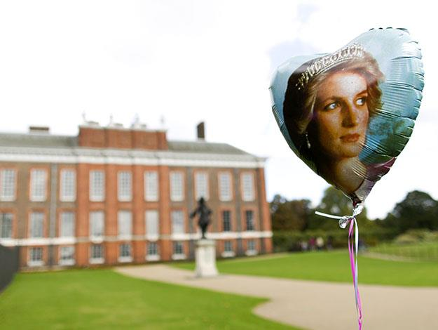 A balloon bearing the picture of Britain's Princess Diana is placed outside Kensington Palace along with other tributes marking the 17th anniversary of her death.