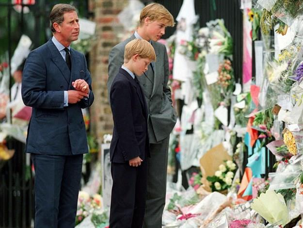 Charles, William and Harry viewing floral tributes to Diana.