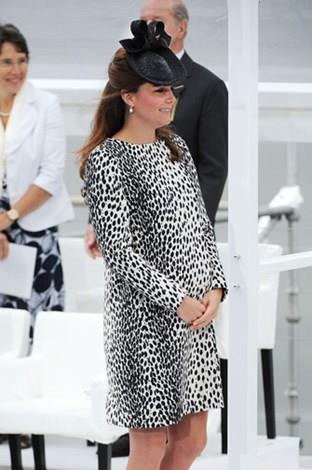 Kate's coat skimmed over her growing bump.