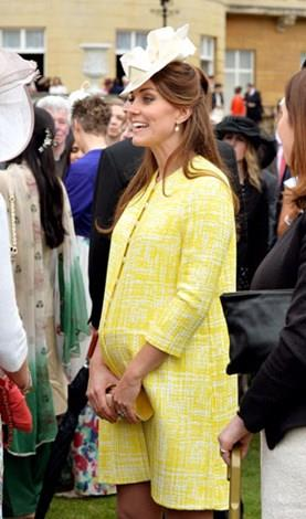Kate was a ray of sunshine in yellow at a garden party in June last year.