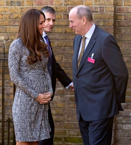 Kate showing off her growing bump in February last year.