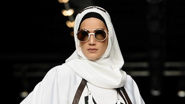 Model wearing hijab showcases designs by Hannie Hananto on the runway during Jakarta Fashion Week 2014.