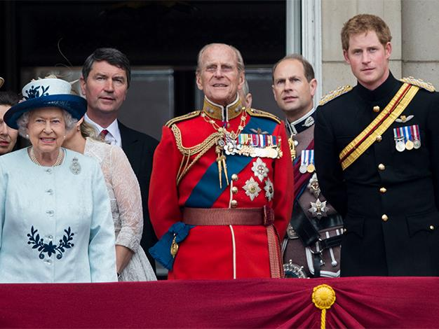 Prince Harry with his grandparents, Queen Elizabeth II and Prince Philip, during Trooping the Colour at The Royal Horseguards on June 14, 2014.
