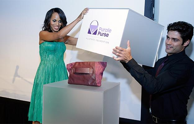 Washington unveils her Purple Purse creation at an Allstate Foundation event in New York on Monday night.