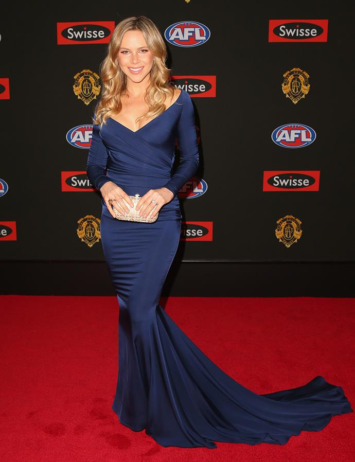 Alex Davis, partner of Scott Pendlebury, looked stunning in a navy number.
