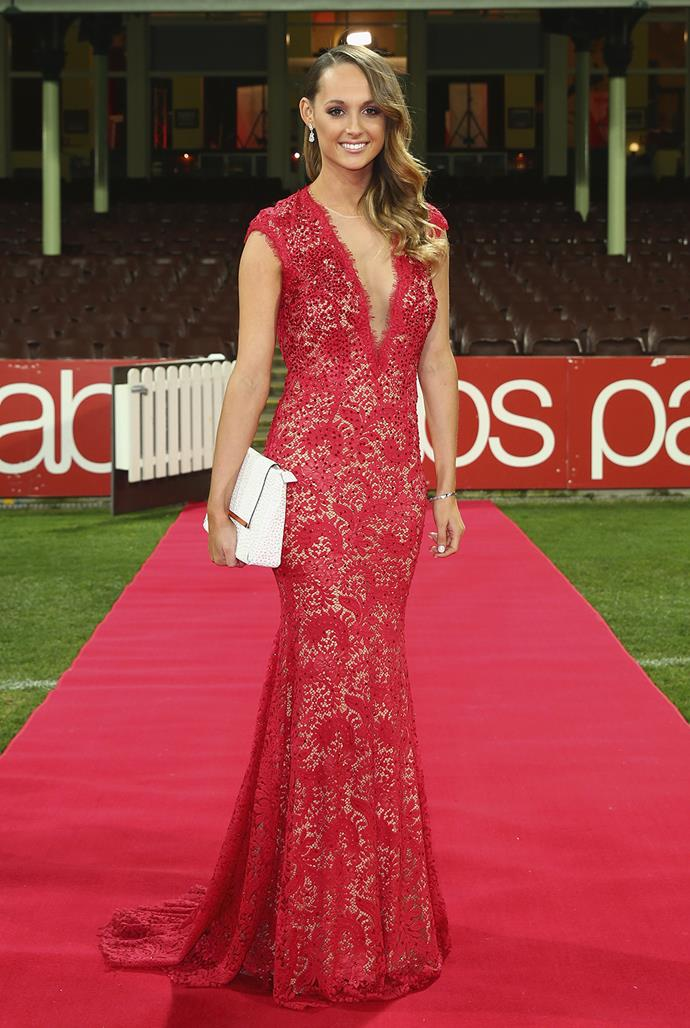 Kate Lawrence, partner of Luke Parker, wore a stunning red gown to the event.