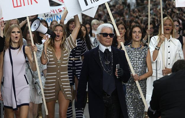 Karl Lagerfeld was seen on the frontline of the march.