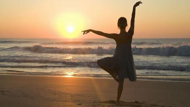 female silhouette sunset beach