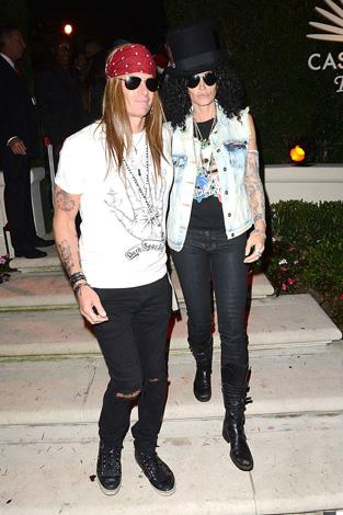 Cindy Crawford andRande Gerber as Slash and Axl Rose from the Guns N' Roses.