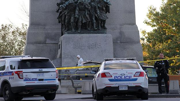 orensic police officers at the National War Memorial in Ottawa, Canada where a gunman killed a soldier.
