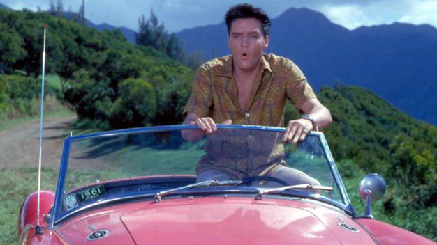 Some of the cars used in Elvis' films were recently featured in a British exhibition, including this red MG from the 1961 film Blue Hawaii.