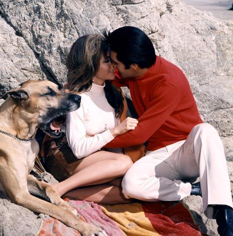 Nancy Sinatra is kissed by Elvis Presley in a scene from the film 'Speedway', 1968.