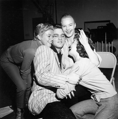 Elvis gets mobbed by girls backstage of the Milton Berle Show in Burbank, California on June 4, 1956.