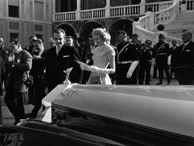 1956: Prince Rainier III of Monaco, with Grace Kelly, receiving the car as a wedding gift from the people of Monaco, the day before their marriage ceremony.