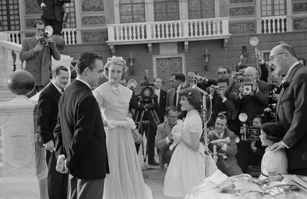1956: A white dove is presented to film star Grace Kelly and Prince Rainier III as a gift from the people of Monaco on their wedding day.