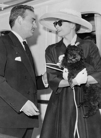 1956: Prince Rainier III of Monaco joins his then-fiancee Grace Kelly and her dog, Oliver, aboard the princely yacht 'Deo Juvante II' in Monte Carlo's harbour as Kelly arrives from USA for their wedding ceremony.
