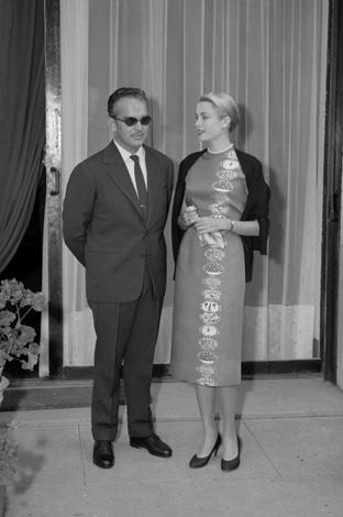 1956: Prince Rainier and Princess Grace of Monaco pose for photographer after a short walk near their Paris home.