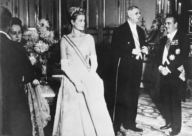 1959: Princess Grace of Monaco and Prince Rainier with former French President, Charles de Gaulle at a banquet in their honour at the Elysee Palace, Paris, 14th October 1959.