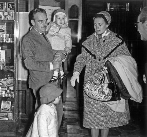 1959: Prince Rainier III of Monaco carrying in his arms his son Albert, and Princess Grace and daughter Caroline in Saulieu.