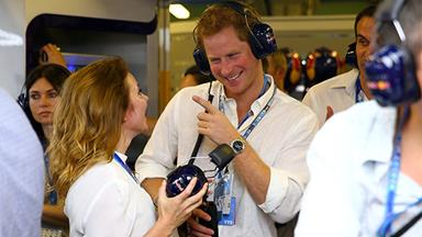 Prince Harry laughs with Geri Halliwell at the Grand Prix