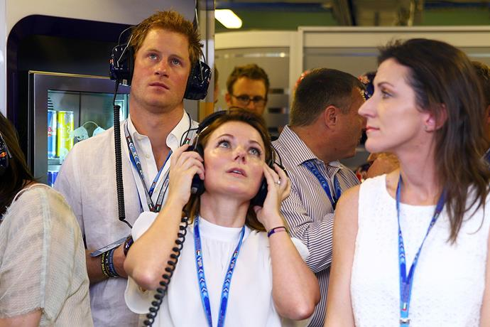 Prince Harry watches the action.