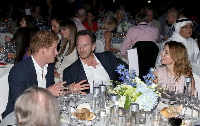Prince Harry, Christian Horner and Geri Halliwell speak during a dinner after the Sentebale Polo Cup.