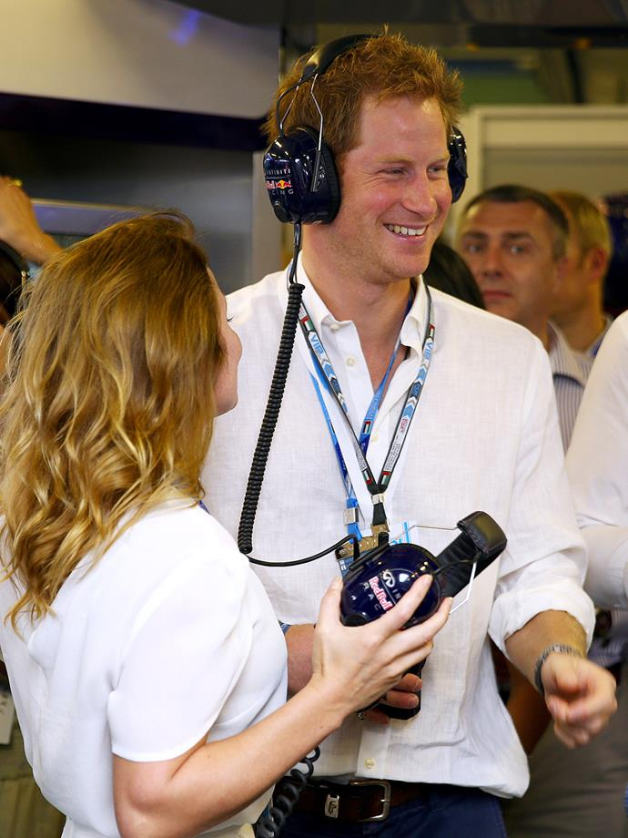 Prince Harry and Geri Halliwell in the Red Bull garage.
