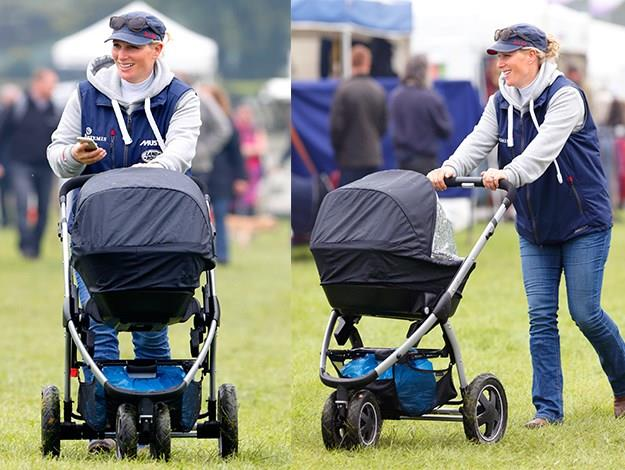 Zara pushes daughter Mia Tindall in her pushchair as she attends the SYMM International Horse Trials in April in Hambleden, England.