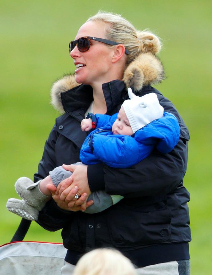 Zara Phillips carries her baby daughter Mia Tindall.