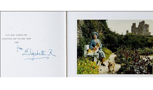 A card from the Queen Mother, posed at the Castle of Mey, with her beloved corgis in 1986.