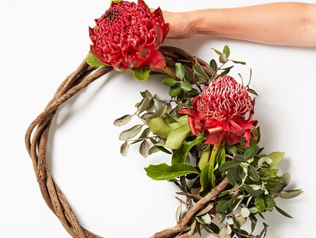 Cut the stems of your flowers to around 4cm. Using small bunches of foliage and flowers at a time, secure the stems of both to the wreath with cable ties.