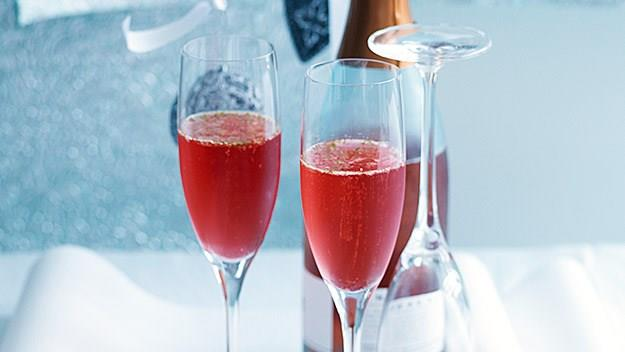 "**Cranberry and lime cocktail** <br><br> Classy with a touch of fizz! These zingy cocktails will keep your guests (and their taste buds) happy! <br><br> [**Read the full recipe here**](https://www.womensweeklyfood.com.au/recipes/cranberry-and-lime-cocktail-13044|target=""_blank"")"