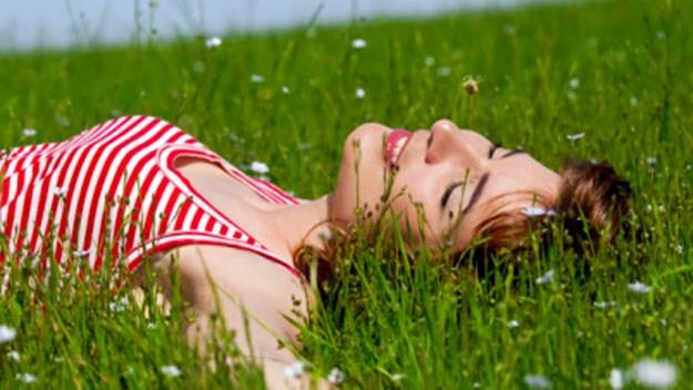 woman laying in grass, stock image