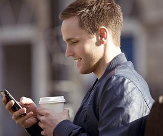 man on mobile phone with coffee, stock image