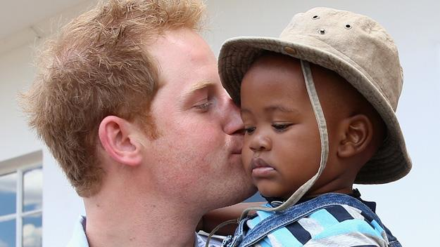 Prince Harry kissing African child