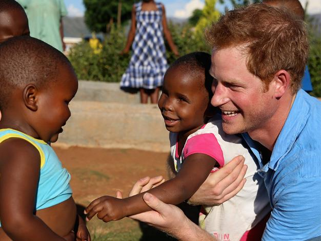 Making friends. Prince Harry on his Lesotho trip.