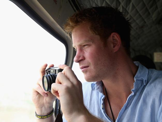 Prince Harry turned photographer on trip to visit his charity.