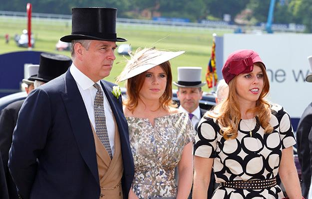 Prince Andrew the Duke of York with daughters, Princess Eugenie and Princess Beatrice at a race day in 2013.