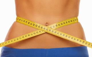 Woman's waist with measuring tape, diet, stock image