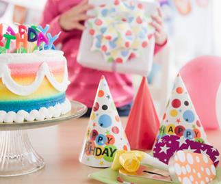 Birthday cake among other expensive party favours.