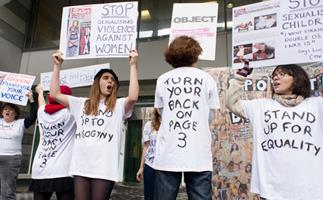 Women protest The Sun's topless page 3 girl tradition.