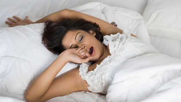 Social Jet lag, woman yawning in bed