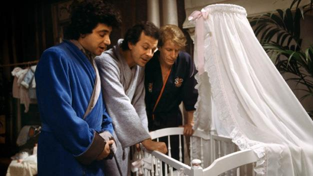 The 1985 French film, 3 Hommes et un Couffin (Three Men and a Cradle).